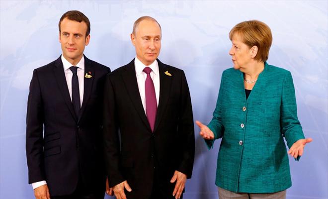 ميركل وماكرون يطالبون بوتين بالضغط على الأسد لوقف القتال في الغوطة