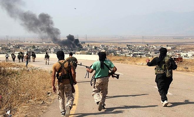 الثوار يشنون هجوماً على مواقع عصابات الأسد شمال حماة