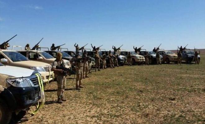 مغاوير الثورة والتحالف الدولي يقومان بتدريبات بالذخيرة الحية في قاعدة التنف